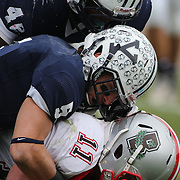 Brian Strachan, Brown, (bottom), is tackled by Cole Champion and William Vaughan, (top), Yale, during the Yale V Brown, Ivy League Football match at Yale Bowl. Yale won the match 24-17. New Haven, Connecticut, USA. 9th November 2013. Photo Tim Clayton