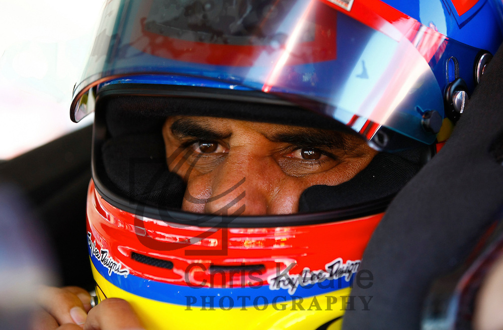 Driver Juan Pablo Montoya of Columbia prepares his helmet before the start of the NASCAR Sprint Cup Series Coca-Cola 600 autorace in Concord, North Carolina May 27, 2012. REUTERS/Chris Keane (UNITED STATES)