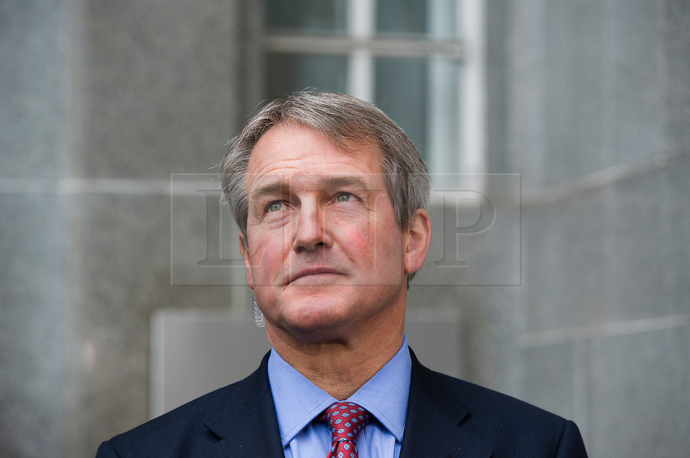 © London News Pictures. 09/02/2013 . London, UK.  Secretary of State for Environment, Food and Rural Affairs, OWEN PATERSON talking to media outside the Department for the Environment, Food and Rural Affairs in London after meeting with representatives of the FSA, as well as food retailers and suppliers, to discuss the unfolding scandal over horsemeat being found in various products.. Photo credit : Ben Cawthra/LNP