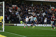 Stephen Ward of Burnley clears a cross under pressure from Joe Garner of Preston during the Sky Bet Championship match between Preston North End and Burnley at Deepdale, Preston, England on 22 April 2016. Photo by Simon Brady.