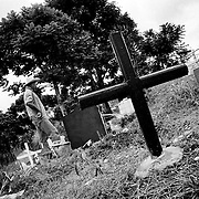 Since the breakdown of the peace process this cemetery worker has dug graves for more than 100 victims of assassination. Some were murdered by the FARC because they knew too much about the locations of camps and the workings of the organistation others were killed by the paramilitaries for being linked to the FARC.<br />