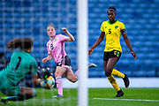 Konya Plummer (#5) of Jamaica watches as Sydney Schneider (#1) of Jamaica saves the shot from Kim Little (#8) of Scotland during the International Friendly match between Scotland Women and Jamaica Women at Hampden Park, Glasgow, United Kingdom on 28 May 2019.