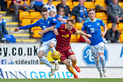 Scott Tanser (#3) of St Johnstone FC tackles Danny Johnson (#24) of Motherwell FC during the Ladbrokes Scottish Premiership match between St Johnstone and Motherwell at McDiarmid Stadium, Perth, Scotland on 11 May 2019.