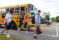 Students arrive at Laconia Middle School Tuesday morning for their first day of classes.   (Karen Bobotas/for the Laconia Daily Sun)