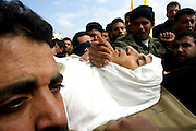 Palestinian mourner bid farewell during a mass funeral to one of the victims killed  March 3, 2003 in the Bourge refugee camp in the Gaza Strip. Israeli forces killed e