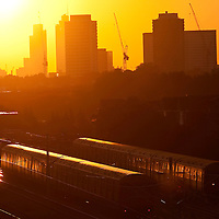 London Underground  trains come and go through West Ham Station against an October sunset over the City of London..11th Oct 2010..Photo Andrew Baker.07977074356