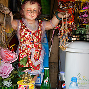 "MANILA (Philippines). 2009. Figure of ""Santo Nino"" in a kiosk in Manila. ""Santo Nino""  is the patron saint of several Philippine cities, and Manila's Tondo and Pandacan Districts."