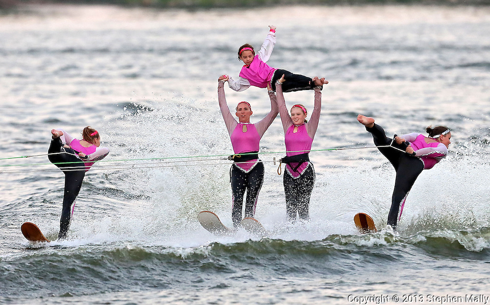 Angie Pretasky (from left), Mary Bortz, Nora Brandt, 7, Amber Bortz, 15, and Darcy Kohn perform during the Five Seasons Ski Team show on the Cedar River in Cedar Rapids on Thursday, August 29, 2013.