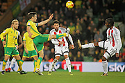 Norwich City midfielder Jonathan Howson and Brentford midfielder Romaine Sawyers (19) battle for the ball during the EFL Sky Bet Championship match between Norwich City and Brentford at Carrow Road, Norwich, England on 3 December 2016. Photo by Nigel Cole.