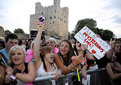 ©  licensed to London News Pictures. UK. 14/07/2011.  Fans at the concert. Peter Andre performs at The Rochester Castle Concert in Medway, Kent. He was supported by The Reason 4 from the X-factor television show. Please see special instructions. Picture credit should read Grant Falvey/LNP.