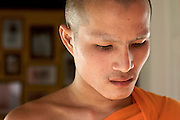 A Close up Portrait of a monk, watching over the Photo exhibition in Luang Prabang, Laos