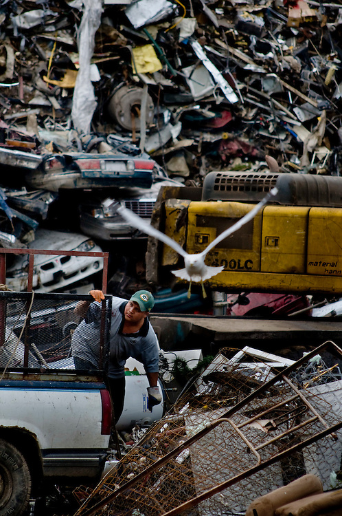 A scrap metal collector unloading metal junk at the General Iron scrap metal yard in Chicago, where scrap metal is bought and recycled.<br /> <br /> Photographer: Chris Maluszynski /MOMENT