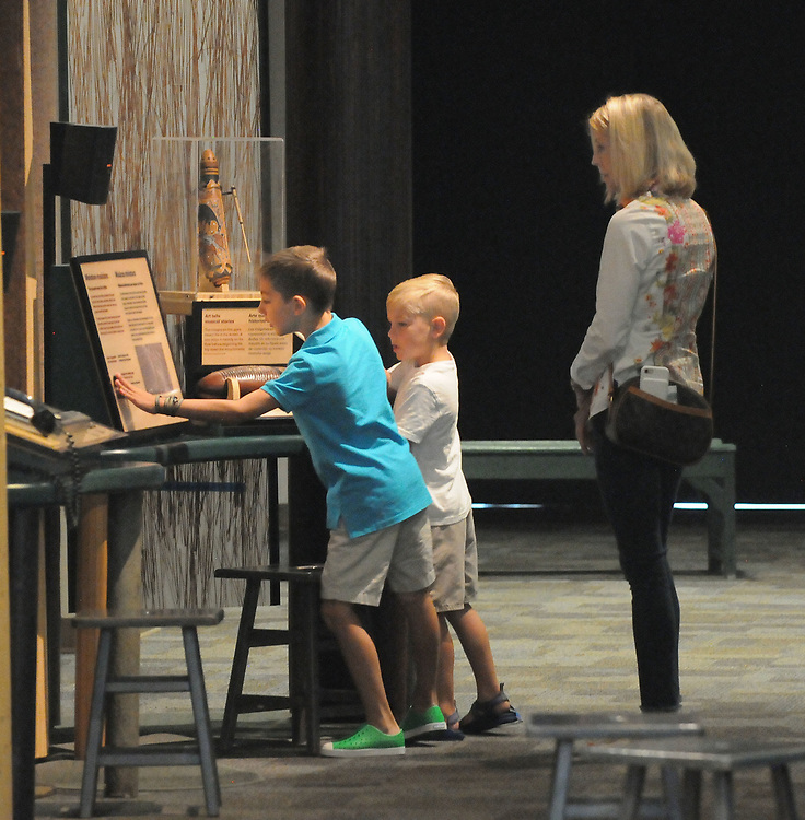 jt062717e/arts/jim thompson/ Nancy Williams with her grandkids (left to right) Stone and Benjamin Williams as they check out one of the hands-on exhibits of the Wild Music: Sounds and Songs of Life Exhibit at the New Mexico Museum of Natural History and Science.Tuesday June. 27, 2017. (Jim Thompson/Albuquerque Journal)