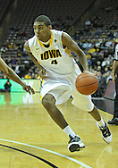 December 04 2010: Iowa Hawkeyes guard/forward Roy Devyn Marble (4) drives with the ball during the second half of their NCAA basketball game at Carver-Hawkeye Arena in Iowa City, Iowa on December 4, 2010. Iowa won 70-53.