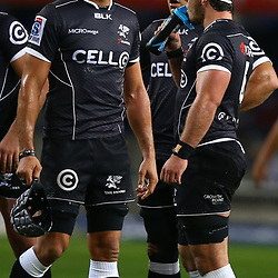 DURBAN, SOUTH AFRICA - JUNE 13: Marco Wentzel (captain) of the Cell C Sharks with Marcell Coetzee of the Cell C Sharks during the Super Rugby match between Cell C Sharks and DHL Stormers at Growthpoint Kings Park on June 13, 2015 in Durban, South Africa. (Photo by Steve Haag/Gallo Images)