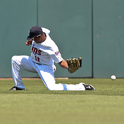 March 13, 2011; Fort Myers, FL, USA; Minnesota Twins center fielder Ben Revere (11) loses a fly ball in the sun during a spring training exhibition game against the Philadelphia Phillies at Hammond Stadium.   Mandatory Credit: Derick E. Hingle