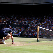 LONDON, ENGLAND - JULY 14: A ball boy watches Roger Federer of Switzerland in action against Thomas Berdych of the Czech Republic in the Gentlemen's Singles Semi-final of the Wimbledon Lawn Tennis Championships at the All England Lawn Tennis and Croquet Club at Wimbledon on July 14, 2017 in London, England. (Photo by Tim Clayton/Corbis via Getty Images)