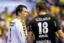 Slawomir Szmal (#1) of RNL and Bjarte Myrhol (#18) of RNL during Velux EHL Champions league 2010/2011 Group A men handball match between HC Celje Pivovarna Lasko of Slovenia and Rhein-Neckar Loewen of Germany, on October 2, 2010 in Arena Zlatorog, Celje, Slovenia. Rhein-Neckar Löwen defeated Celje Pivovarna Lasko 32 - 28. (Photo By Vid Ponikvar / Sportida.com)