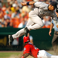 17 June 2006:  The New York Yankees third baseman Alex Rodriguez (13) tries to catch an errant throw from catcher Jorge Posada in the eighth inning on a successful steal of third base by the Washington Nationals Alfonso Soriano (12).  Soriano was able to score on the throw to tie the game as the Nationals defeated the Yankees 11-9 at RFK Stadium in Washington, D.C.