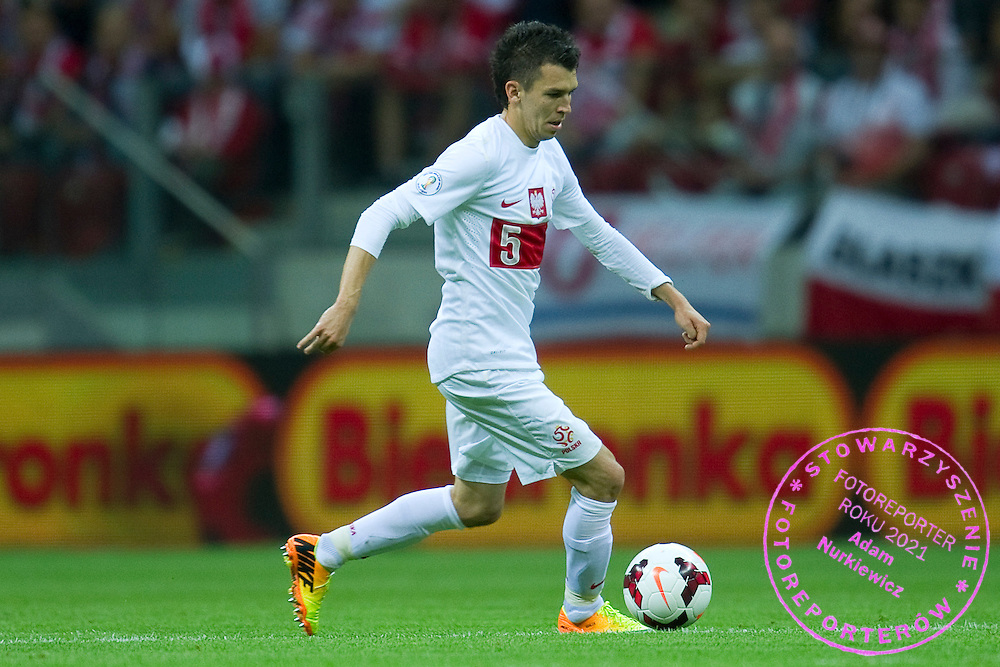 Poland's Waldemar Sobota controls the ball during the 2014 World Cup Qualifying Group H football match between Poland and Montenegro at National Stadium in Warsaw on September 06, 2013.<br /> <br /> Poland, Warsaw, September 06, 2013<br /> <br /> Picture also available in RAW (NEF) or TIFF format on special request.<br /> <br /> For editorial use only. Any commercial or promotional use requires permission.<br /> <br /> Mandatory credit:<br /> Photo by &copy; Adam Nurkiewicz / Mediasport