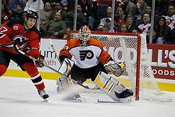 Mar 30, 2007; East Rutherford, NJ, USA; New Jersey Devils right wing Michael Rupp (17) tips a New Jersey Devils defenseman Brad Lukowich (21) shot past Philadelphia Flyers goalie Martin Biron (43) during the second period at Continental Airlines Arena in East Rutherford, NJ.