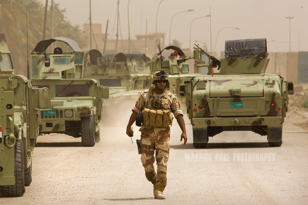 MOSUL, IRAQ - JUNE 05: Iraqi soldiers with the 2nd Division return to their base from a morning mission, on June 5 , 2010, in Mosul, Iraq. Iraq faces multiple challenges in the lead-up to the drawn-down of US forces in Iraq, with many observers claiming that while they have the capablities of handling home-grown problems, they are far from being able to tackle external threats. Political wrangling has reportedly fostered greater instability throughout the country with fears of renewed sectarian violence breaking out as insurgents set-up attacks in an attempt to exploit vulnerabilities amongst the populace. (Photo by Warrick Page)