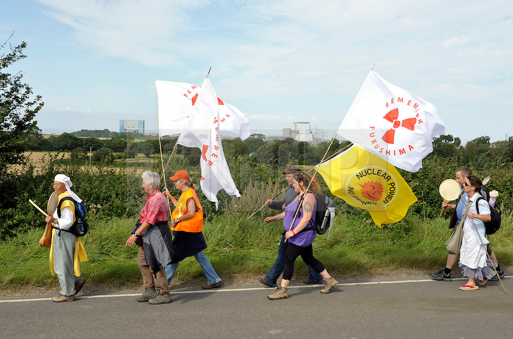 © Licensed to London News Pictures. 01/09/2012. Bristol, UK.  A group of supporters of the campaign against a new nuclear power station arrive at Hinkley Point nuclear power station, having walked all the way from Aldermaston in Berkshire to Hinkley Point in Somerset.  The walkers will include Buddhists from the Peace Pagoda in Milton Keynes, people with direct experience of the aftermath of the nuclear accident at Fukushima in Japan last year. Their basic message is that they will ?walk and pray for a change in culture, thinking and heart?.  01 September 2012..Photo credit : Simon Chapman/LNP