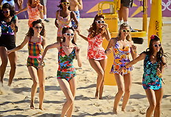 Dancers entertain the crowd during a break in Beach Volleyball.