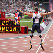 LONDON 2012 PARALYMPIC GAMES.. PIC SHOWS RICHARD WHITEHEAD AFTER WINNING GOLD IN THE 200M T42 RACE AT THE OLYMPIC STADIUM LONDON  ON SATURDAY 1 SEPTEMBER 2012