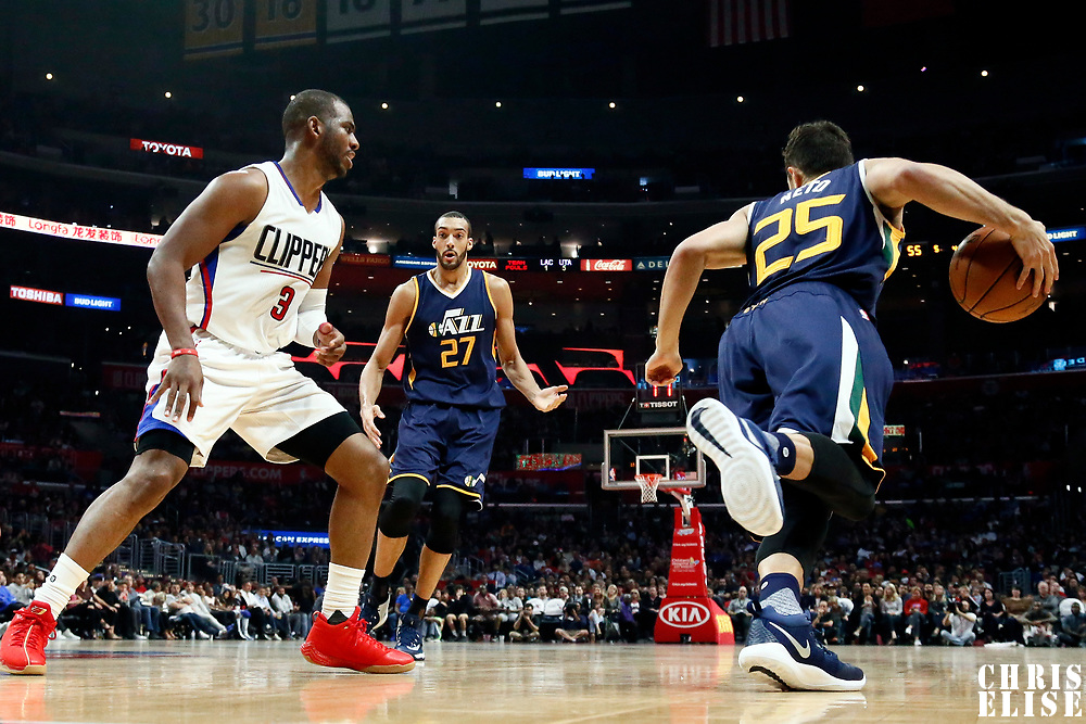 25 March 2016: Utah Jazz guard Raul Neto (25) drives past LA Clippers guard Chris Paul (3) as Utah Jazz center Rudy Gobert (27) sets a screen during the Los Angeles Clippers 108-95 victory over the Utah Jazz, at the Staples Center, Los Angeles, California, USA.