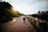 A man walks along the Red River, which separates Vietnam and China in the town of Lao Cai.