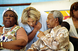 NELSON ROLIHLAHLA MANDELA (July 18, 1918 - December 5, 2013), 95, world renown civil rights activist and world leader. Mandela emerged from prison to become the first black President of South Africa in 1994. As a symbol of peacemaking, he won the 1993 Nobel Peace Prize. Joined his countries anti-apartheid movement in his 20s and then the ANC (African National Congress) in 1942. For next 20 years, he directed a campaign of peaceful, non-violent defiance against the South African government and its racist policies and for his efforts was incarcerated for 27 years. Remained strong and faithful to his cause, thru out his life, of a world of peace. Transforming the world, to make it a better place. PICTURED:  February 24, 1999 - NELSON MANDELA talks to his assistant ZELDA LE GRANGE in Eastern Cape, former Transkei.  (Credit Image: © Greg Marinovich/ZUMA Wire/ZUMAPRESS.com)