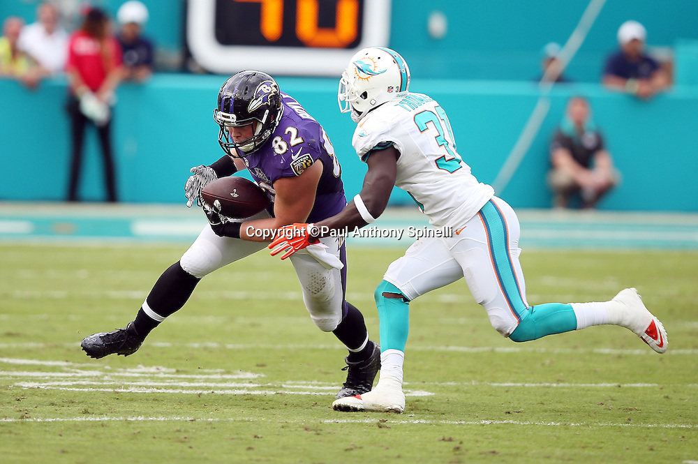 Baltimore Ravens tight end Nick Boyle (82) is chased by Miami Dolphins free safety Michael Thomas (31) as he catches a third down pass good for a second quarter first down during the 2015 week 13 regular season NFL football game against the Miami Dolphins on Sunday, Dec. 6, 2015 in Miami Gardens, Fla. The Dolphins won the game 15-13. (©Paul Anthony Spinelli)