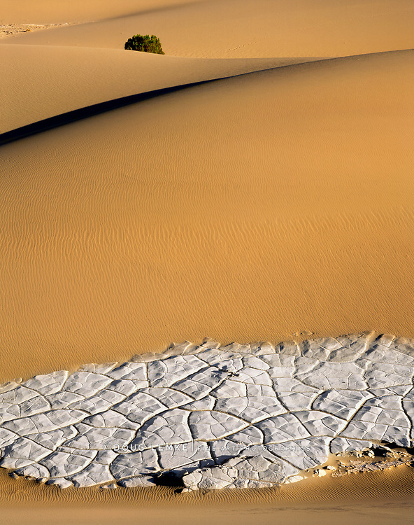 Sand Ripples And Dried Cracked Mud On A Sand Dune At Stove Pipe Wells In Death Valley National Park, California, USA