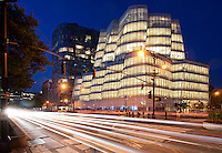 architecture photography New York City:  InterActiveCorp's headquarters (IAC building) at the blue hour and designed by architect Frank Gehry located at 550 West 18th Street on the corner of Eleventh Avenue in the Chelsea neighborhood of Manhattan, New York City, NYC