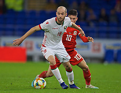 CARDIFF, WALES - Monday, September 9, 2019: Belarus' Ivan Mayeuski (L) and Wales' Harry Wilson during the International Friendly match between Wales and Belarus at the Cardiff City Stadium. (Pic by David Rawcliffe/Propaganda)