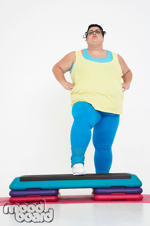 Plus-Size Woman on Exercise Steps