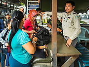 25 OCTOBER 2016 - MAE SOT, TAK, THAILAND:  Thai government officials conduct inspections on the Thai side of the border in Mae Sot. The Thai-Myanmar border between Mae Sot and Myawaddy has become an important commercial crossing as democratic reforms in Myanmar (Burma) has created new economic opportunities in Thailand.   PHOTO BY JACK KURTZ