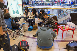 © Licensed to London News Pictures. 19/09/2014. Customers line up outside the Apple store ahead of the public release of the iphone 6 at the Apple Store in Chadstone Melbourne Australia. Australia is one of the first countries in the world to sell the iphone 6 due to geographic location & time zone. Photo credit : Asanka Brendon Ratnayake/LNP