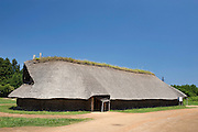 Photo shows a reconstruction of a long house, measuring 32 meters in length at Sannai-Maruyama, a large settlement  of the early to middle Jomon era, about 5,500 to 4,000 years ago, in Aomori Prefecture, Japan on 12 July 2011..Photographer: Robert Gilhooly