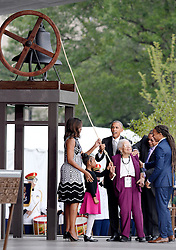 U.S President Barack Obama and First Lady Michelle Obama are join up with the Bonner Family to ring the onstage bell. during the opening ceremony of the Smithsonian National Museum of African American History and Culture on September 24, 2016 in Washington, DC, USA. The museum is opening thirteen years after Congress and President George W. Bush authorized its construction. Photo by Olivier Douliery/Pool/ABACAPRESS.COM