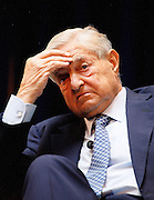 The International Monetary Fund - IMF - holds its annual conference in DC amidst an US and European financial crisis. Financier and Philantropist George Soros believes an orderly default could be the responsible way out for Greece.