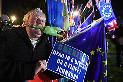 "© Licensed to London News Pictures. 22/10/2019. London, UK.  Boris Johnson impersonator Drew Galdron, 36 from Tooting (aka Faux Bojo) reacts outside The Palace of Westminster in front of College Green following crucial votes for PM Boris Johnson government. MPs backed his Withdrawal Agreement Bill - but minutes later voted against the timetable, placing Brexit ""in limbo"". Photo credit: Guilhem Baker/LNP"