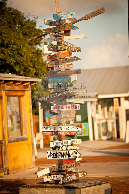 Crossroads sign post showing distance to various cities at the harbor Key West, Florida.