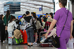 Passengers wait patiently at Terminal 5, Heathrow Airport after an IT glitch brings British Airways systems to a halt, causing disruption to thousands of passengers with flights cancelled and delayed. London, August 07 2019.
