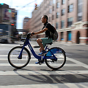 A Citi Bike user in Chelsea, Manhattan, New York. Citi Bike the NYC Bicycle Share Program sponsored by Citi Bank, launched in late May 2013 giving access to thousands of bikes at docking stations throughout  Manhattan and parts of Brooklyn. Manhattan, New York, USA. 24th July 2013. Photo Tim Clayton