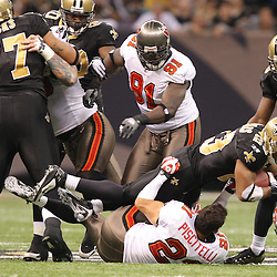 Dec 27, 2009; New Orleans, LA, USA; New Orleans Saints running back Pierre Thomas (23) knocks off the helmet of Tampa Bay Buccaneers safety Sabby Piscitelli (21) during the first quarter at the Louisiana Superdome. Mandatory Credit: Derick E. Hingle-US PRESSWIRE..