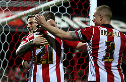 Lasse Vibe of Brentford celebrates scoring his second and his sides third goal with his teammates - Mandatory by-line: Robbie Stephenson/JMP - 05/04/2016 - FOOTBALL - Griffin Park - Brentford, England - Brentford v Bolton Wanderers - Sky Bet Championship