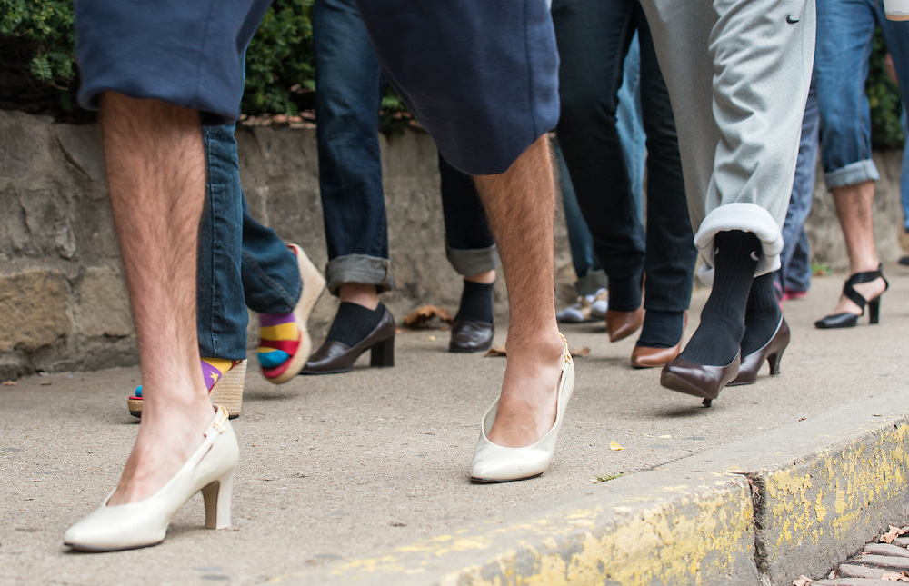 Men of all varieties supported women by participating in the Womens Center Walk a Mile in Her Shoes event by wearing womens shoes and walking through downtown Athens.  Photo by Elizabeth Held