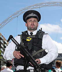 An armed policeman outside the stadium during the Emirates FA Cup Final at Wembley Stadium, London.